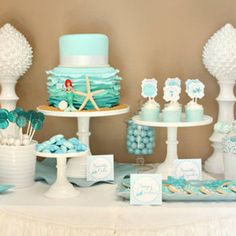Mermaid Birthday Party- love the colors and use of starfish, coral, and other 'sea' goodies. maybe add coral.