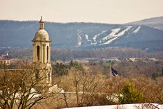 Old Main Bell Tower with Tussey Mountain in the Background