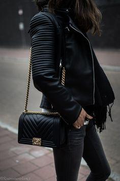9c839976c654 Brunette woman wearing a black leather jacket from Zara with a black  chevron Chanel Boy bag. High Fashion Designer Handbags