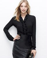 Ruffle Blouse - Undeniably alluring, we love the refined femininity of this polished must-have. Mandarin collar. Long sleeves with button closure. Button front. Shirttail hem.
