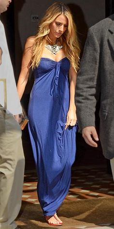 BLAKE LIVELY    Blake knows the power of a statement accessory (or two): Her giant crystal-eagle Lanvin collar necklace and studded red Balenciaga sandals add instant glamour to her breezy blue maxi.