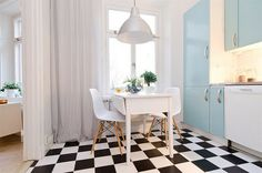 black and white tiles for the kitchen area...and that beautiful blue!