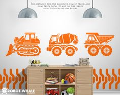 Our favorite construction vehicles up on the wall as vinyl decals. A bulldozer, cement truck, and dump truck ready to head out and start building.
