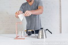 Easily make a pour over coffee maker out of copper pipe with HomeMade Modern. Chemex Coffee, Coffee Cafe, Coffee Shop, Cafetiere Design, Diy Bike Rack, Modern Mailbox, Pour Over Coffee Maker, Homemade Modern, Cleanser