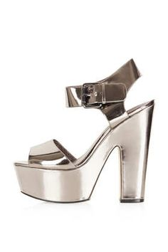 Can't stop peeking at my LARNA 2-Part Metallic Platforms. Can't wait to wear them to the party tonight! #DearTopshop