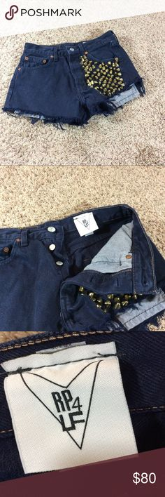 "RP 4 LF Levi high waisted studded shorts RP4LF Levi high waisted grunge shorts   Navy blue with gold studs   Tag size 28 (see measurements)   Cut off distressed   Retail $238   Approx measurements laying flat:  Waist 13""  Inseam 1.5"" Levi's Shorts Jean Shorts"
