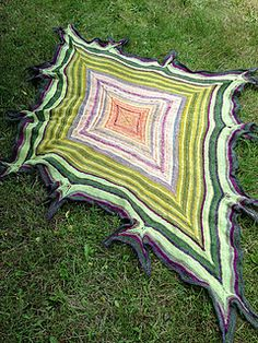Bandersnatch is a rhombus shaped shawl with swallowtail elements along the sides. FREE