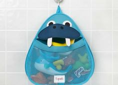3 Sprouts bath storage is the perfect spot for all your little one's bath stuff. Made of the same mildew resistant material used for wetsuits, this bath storage keeps toys dry and your tub organized. The stretchy wide mouth makes grabbing those 'gotta find it now' toys a snap. Best of all, they've included an easy to adhere, slip-proof suction cup which holds on tight to any tile or glass surface.