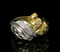 A Diamond Two-Tone Gold Ring