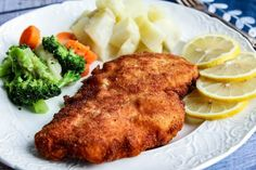 Most commonly made with pork or veal, this recipe switched to chicken. Don't forget the lemon wedges! Lemon is delightful squeezed onto the finished schnitzel. Traditionally, we would serve the dish with potatoes and tangy cooked red cabbage. You will often find it served with fries. Either way, it is a satisfying, tasty dish that you will want to make again soon.
