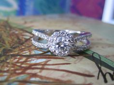 Hey, I found this really awesome Etsy listing at https://www.etsy.com/listing/123565664/white-gold-halo-diamond-ring