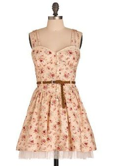 Peach floral dress with brown belt and lace underneath. If this was but several inches longer.