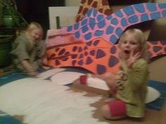 little helpers painting circus decor