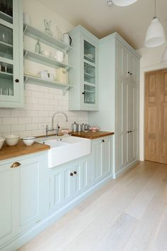 Vintage Kitchen Mint green kitchen cabinets with butcher block counters and white farmhouse sink. Kitchen home decor ideas Mint Green Kitchen, Green Kitchen Cabinets, Kitchen Cabinet Styles, Kitchen Walls, Kitchen Counters, Kitchen Backsplash, Updating Kitchen Cabinets, Open Cabinet Kitchen, Mint Green Decor