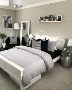 Luxury grey bedroom inspiration, grey and white modern bedroom with picture shelf styling and bedside tables, a reading corner and pillar candlesticks. White Bedroom Design, White Bedroom Decor, Home Decor Bedroom, Bedroom Chair, Bedroom Ideas Grey, Black White And Grey Bedroom, Modern Grey Bedroom, Bedroom Black, Small Grey Bedroom