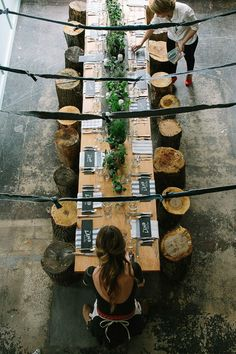 love this table. stumps for seating.