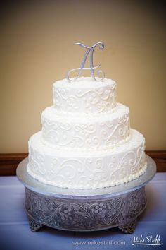 Wedding cake with decorative piping and silver 'A' topper #wedding #cake #Michiganwedding #Chicagowedding #MikeStaffProductions #wedding #reception #weddingphotography #weddingdj #weddingvideography #wedding #photos #wedding #pictures #ideas #planning #DJ #photography