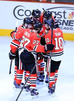 CHICAGO, IL - JUNE 01: (L-R) Patrick Kane #88, Johnny Oduya #27, Michal Handzus #26, Niklas Hjalmarsson #4 and Patrick Sharp #10 of the Chicago Blackhawks celebrate Sharps goal in the second period of Game One of the Western Conference Final against the Los Angeles Kings during the 2013 NHL Stanley Cup Playoffs at United Center on June 1, 2013 in Chicago, Illinois. (Photo by Jamie Squire/Getty Images)