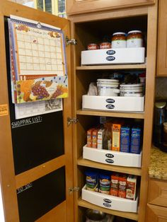 Kitchen pantry closet. I purchased pull out drawers so the items in cabinet are easily accessed. Chalk board contact paper on inside of cabinet makes great place for lists & to hang calendar.