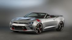 The adage less is more applies to this tasteful yet dynamic Camaro SS convertible. Its Switchblade Silver Metallic exterior is accented with red accessory trim and complemented by an Adrenaline Red leather-trimmed interior.