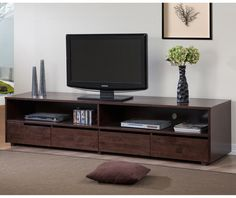 Entertainment center sits low to the floor and looks good in a modern room, Burke 4-drawer Entertainment Center