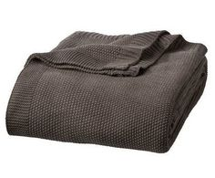 Fall is in the air. Cozy up with this warm knit blanket.