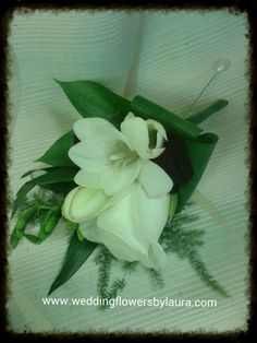 rose and freesia buttonhole www.weddingflowersbylaura.com