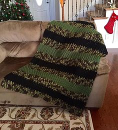 Crocheted throw blanket/lap blanket in camo, black, and olive green
