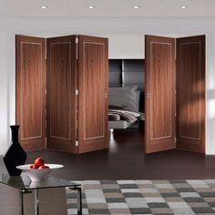 Thrufold Varese Walnut Flush 3+2 Folding Door - Aluminium Inlay - Prefinished - Lifestyle Image.    #walnutfoldingdoors #bifolddoors