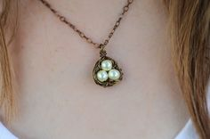 This is a sweet, hand woven birds nest that can be made with anywhere from one to four eggs. The egg (a Swarovski Pearl) comes in pink, blue or white. Other colors avaliable upon request. You can also choose the metal. I have antique bronze (as seen in the pictures,) rhoduim plating (silver) and gold plating. $18.00