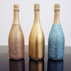 DIY Sparkle Champagne Bottles. This looks like a cute way to decorate and upcycle.