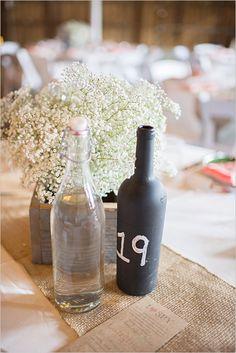 Chalkboard paint table number wine bottles. Captured By: Aimee McAuley --- http://www.weddingchicks.com/2014/05/20/italian-infused-rustic-chic-wedding/