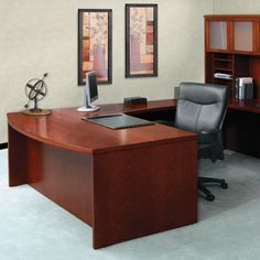 Add a sleek look to your office with this large bow front desk. The desk has a modern design that will let potential clients know that you mean business and take your job seriously. It is large enough to allow a computer and paperwork to be displayed.