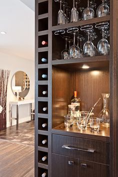 Sleek Modern Wet Bar With Espresso Cabinetry The Bar Area Is Flanked By Cabinets It Features A