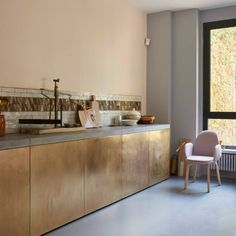 Fritz Hansen showroom styled by Christine Rudolph. She treated the brass cladding with sulphuric acid. The trick, she says, is to add milk to halt the patination process.