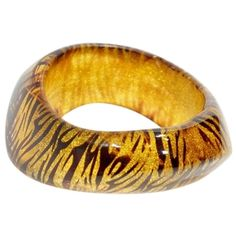 Vintage Pre-owned Vintage Gold Glitter Tiger Lucite Sculpted Acrylic Abstract Bangle Cuf featuring polyvore, fashion, jewelry, bracelets, accessories, gold glitter tiger stripe, tiger bracelet, gold cuff bracelet, cicret bracelet, yellow gold bracelet and gold jewelry