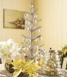Pearly Tree    A smaller tinsel tree with pearlescent ornaments packs a festive punch.