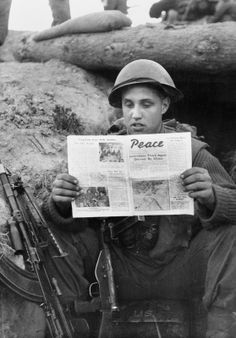 KOREAN WAR 1950 - 1953. Corporal Alex Burnett of the 1st Battalion, The Black Watch reading a Communist peace propaganda newsheet.