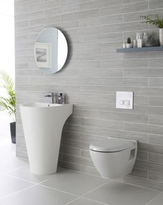 We adore this white and grey bathroom complete with Lavish basin.