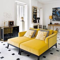 yellow, grey, black living room with tiled floor. Art Deco influence. designer fabrics available DesignNashville.com