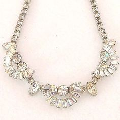 Vintage 1960s  Rhinestone Necklace Mad Men Cocktail by Revvie1, $22.00    I've always loved rhinestone necklaces that incorporated different shapes of stones.