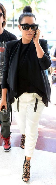 fef0336442c80 Kim Kardashian   Pants – Helmut Lang Wallet – Chanel Shoes – Givenchy  Sunglasses – Celine