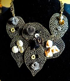 Multi-leaf design with beautiful gems and flowers, perfect for a night out