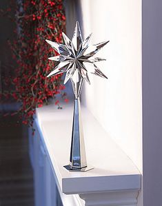 Swarovski Silver and Crystal Rockefeller Tree Topper. I absolutely NEED this. Seriously, if anyone has one just name your price :)