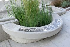 Stormwater planter with bench and historic photo tiles, Maynard green street, Seattle. By SvR Design Co.