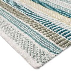 When your home needs a quick update, the Stripe Woven Accent Rug from Threshold™ will do just the trick. This rug has a cool pattern of green and blue geometric stripes, bringing easy style wherever you need it. With the long rectangular shape, this rug makes the perfect piece for an entryway or hallway.