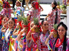 mexico sonora traditions cultures women fiestas | Women from Papaloapam in their colorful dress hold pineapples as props ...