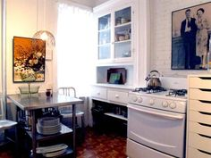 I LOVE that picture above the stove. very personalized.. this whole apartment (460 sq ft) is absolutely amazing