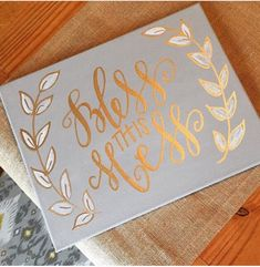 A personal favorite from my Etsy shop https://www.etsy.com/listing/268682017/bless-this-mess-grey-and-gold-hand
