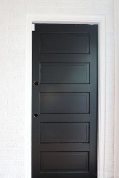 White Paint and Black Doors Bring an Old Mudroom Back to Life. We used Sherwin Williams Extra White on the walls for a fresh and clean white paint. Then we used Tricorn Black on the doors for a deep and true black paint color. Love these classic paint colors in this space! #paintcolor #whitepaintcolor #blackpaintcolor #doorcolor